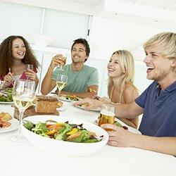Social well-being: Friends socialising at a dinner party